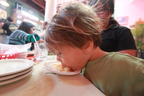 child eats chips like animal at guero's