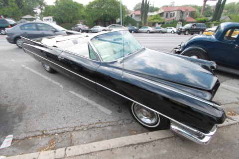 huge convertible black cadillac