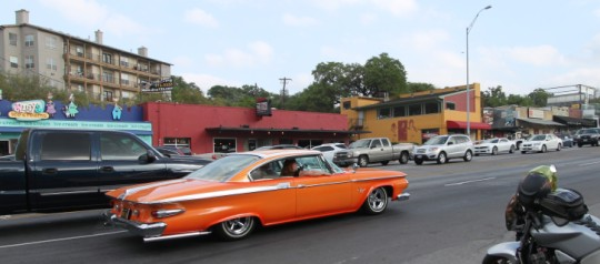 orange and white plymouth fury at lonestar roundup