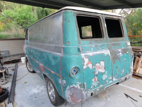 multicolored early econoline van ford 1965