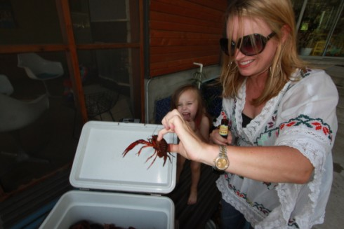 little girl frightened by louisiana crawfish