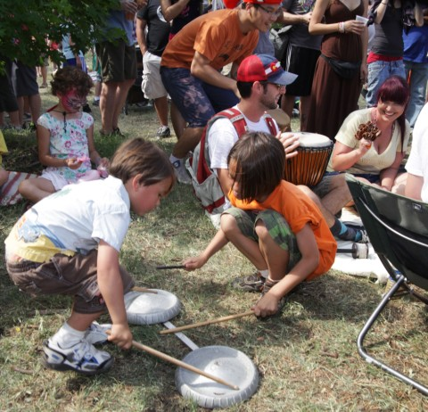 kids at the drum circle beat 1965 ford econoline hubcaps at eeyore's birthday 2012