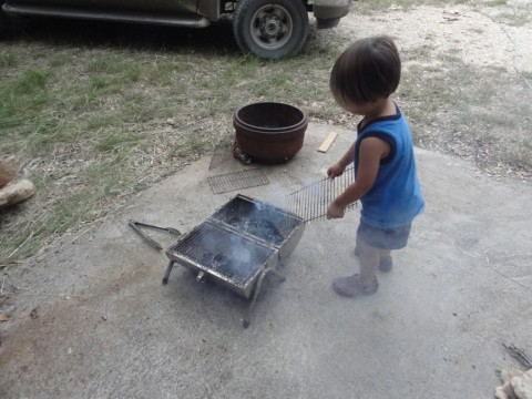 boy learns to work the grill