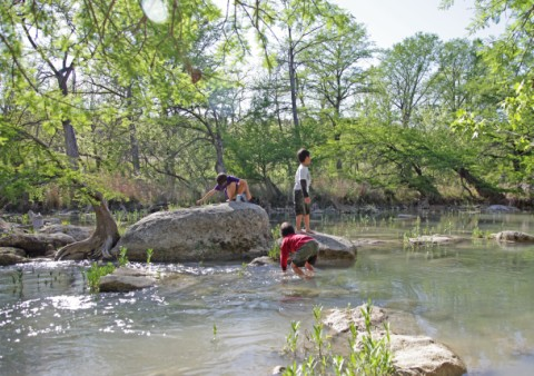 boys playing in the blanco river near wimberley fischer texas