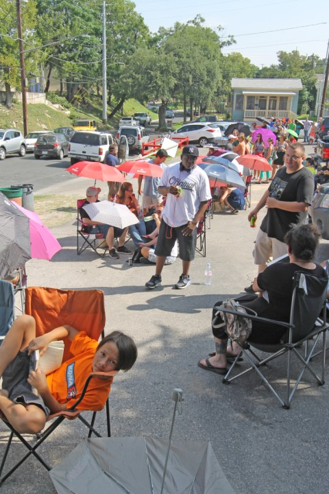 line at franklin barbecue chairs and umbrellas