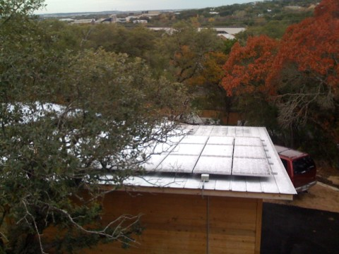 pv panels with snow in austin