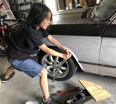 torquing the lug nuts with a breaker bar