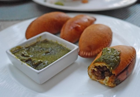 empanadas with chimichurri sauce TRACE W Hotel Austin Happy Hour
