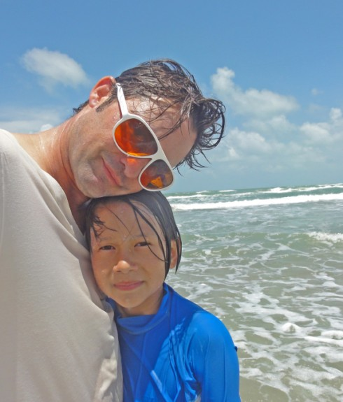 father and son at beach texas tx spi