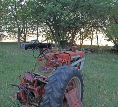 nebraska sunset on old tractor