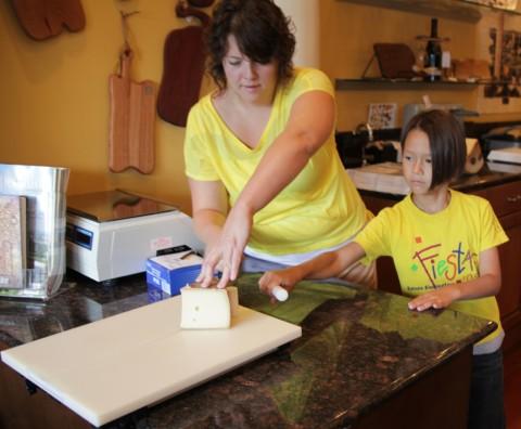 molto formaggio kid cutting the alpine style cheese dallas