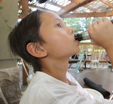 boy drinking beer (maine rootbeer)