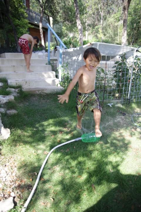 monkey boy jumps over the redneck sprinkler austin tx west lake hills eanes