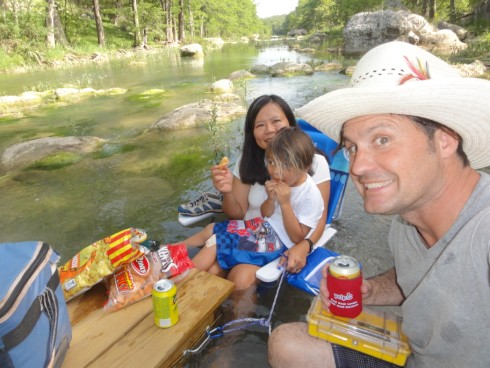 happy hour on the blanco river with pork rinds, shiner bock and a ten gallon cowboy hat