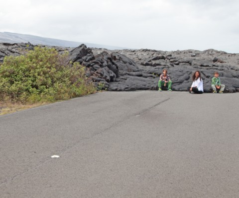 hawaii lava flow over road