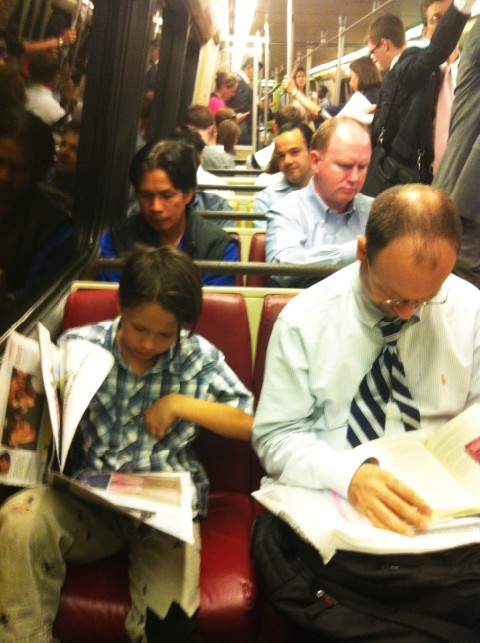 dc metro commuters read the paper