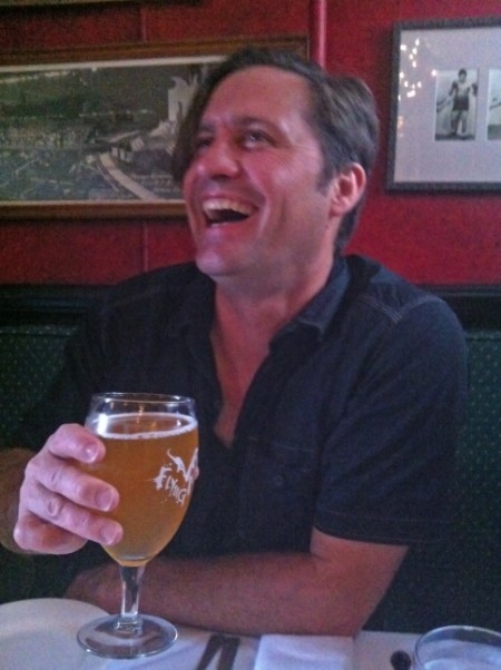 happy guy with draft beer at henninger's tavern fell's point baltimore md