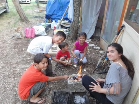 kids grilling marshmallows in texas june heat