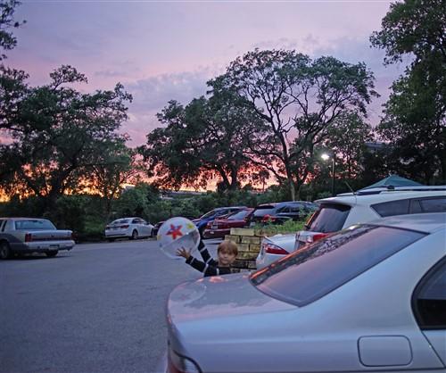 sunset at strange land brewery austin west lake hills