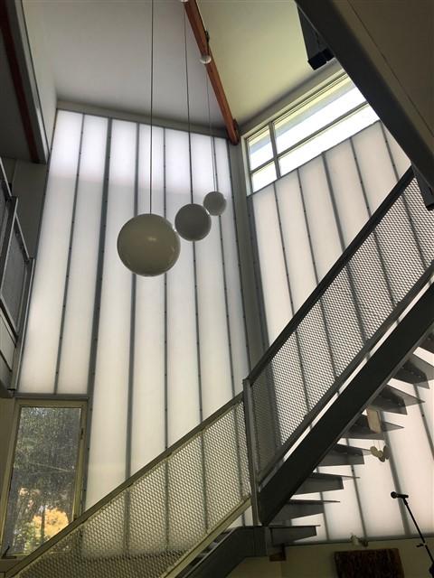 aluminet sun shade over polygal wall 78746 reduce solar gain austin