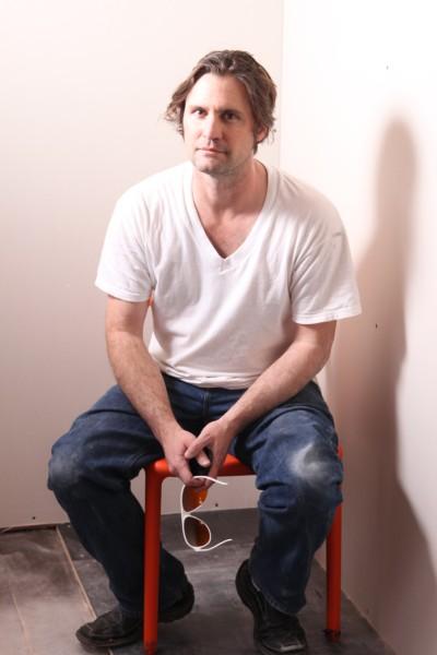 sitting drywall dude