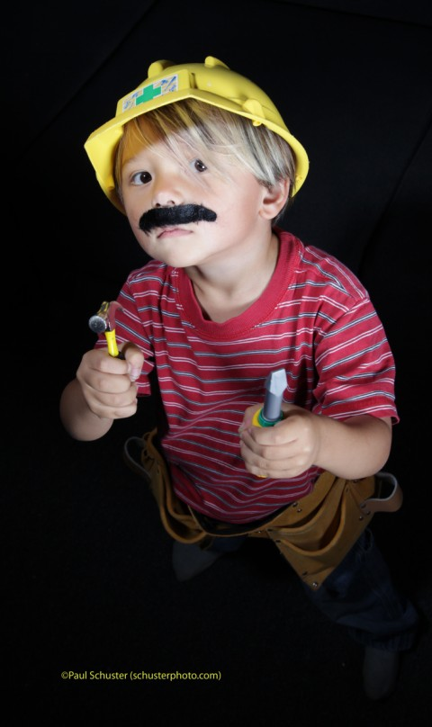 boy with tool belt and mustache