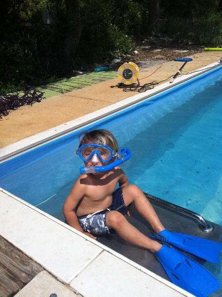 toddler in flippers and swim goggles