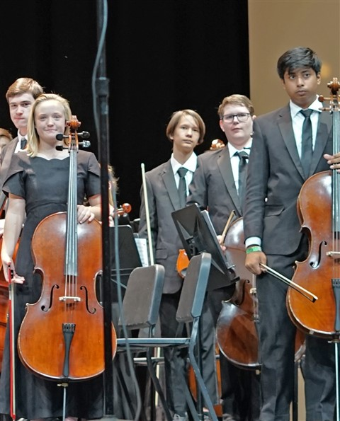 annoyed son doesn't like having picture taken orchestra