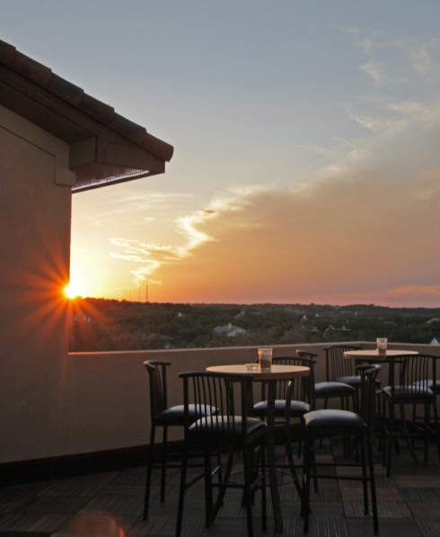 sunset from trudy's 4 star four star dripping springs rooftop deck party