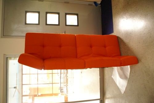 levitating orange sofa