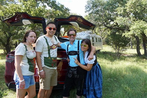 tesla x and airstream in the texas hill country with lederhosen